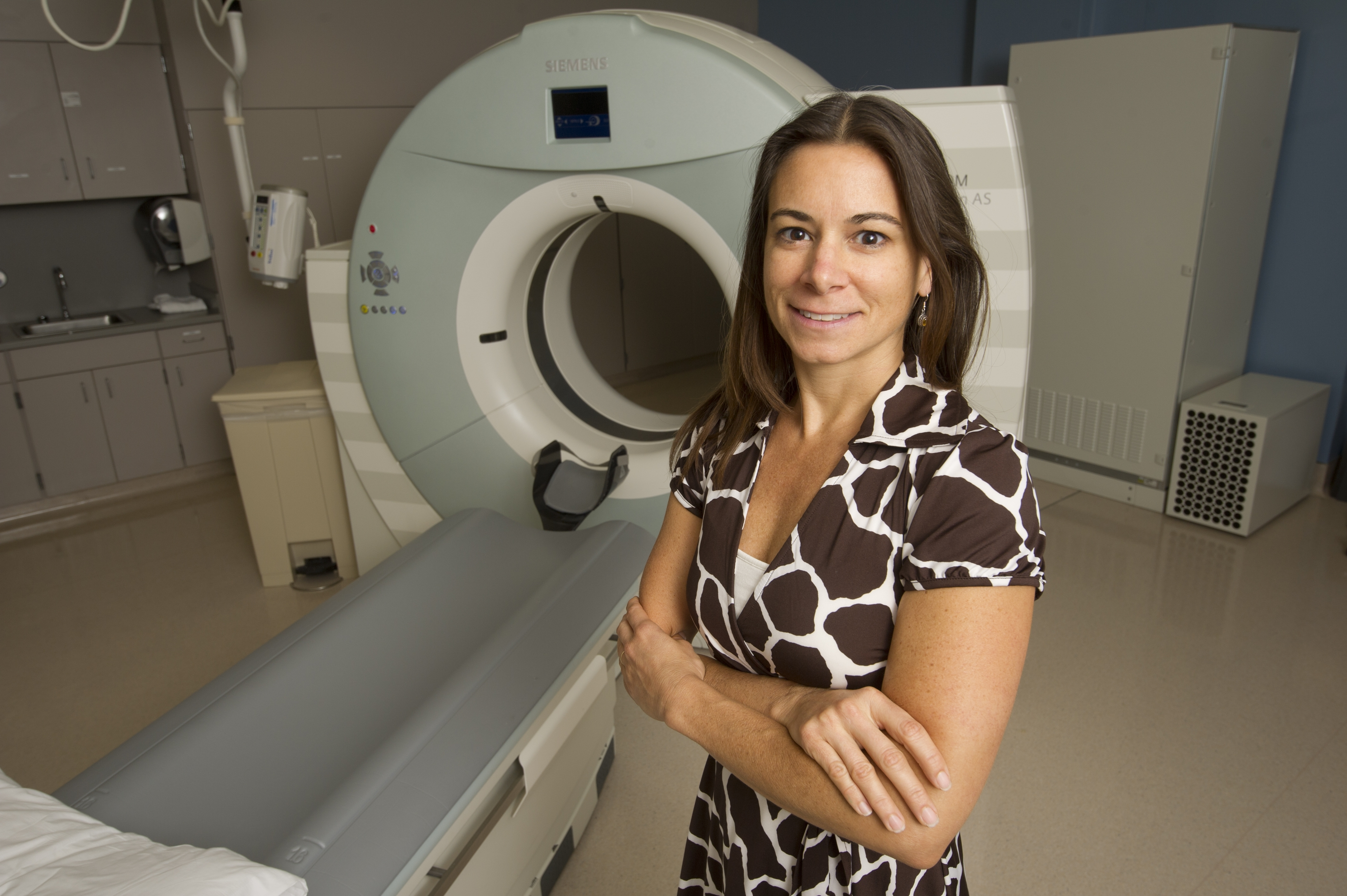 Diana Miglioretti, PhD, the lead researcher, standing next to a CT scanner. Photo credit: UC Davis Health System, Sacramento, CA.
