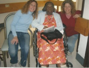 Benzena Tucker (center) spent the last few years of her life in a public nursing home with peeling paint and overworked staff. She had no family and had been too ill to work for many years. At her side, are two volunteers, Wendy Josephs (l.) and Ricki Lewis (r.).